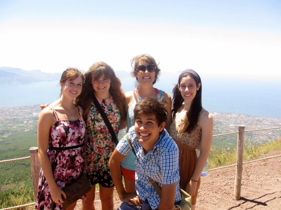 A group of students in front of a scenic landscape